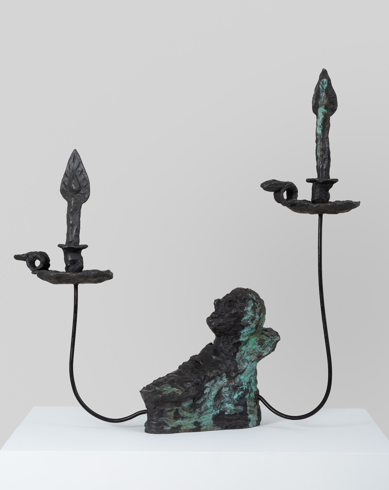 <em>head resting with two candles</em>, 2017<br />Bronze and steel<br />27 1/2 x 23 1/2 x 18 inches (69.9 x 58.4 x 43.8 cm)