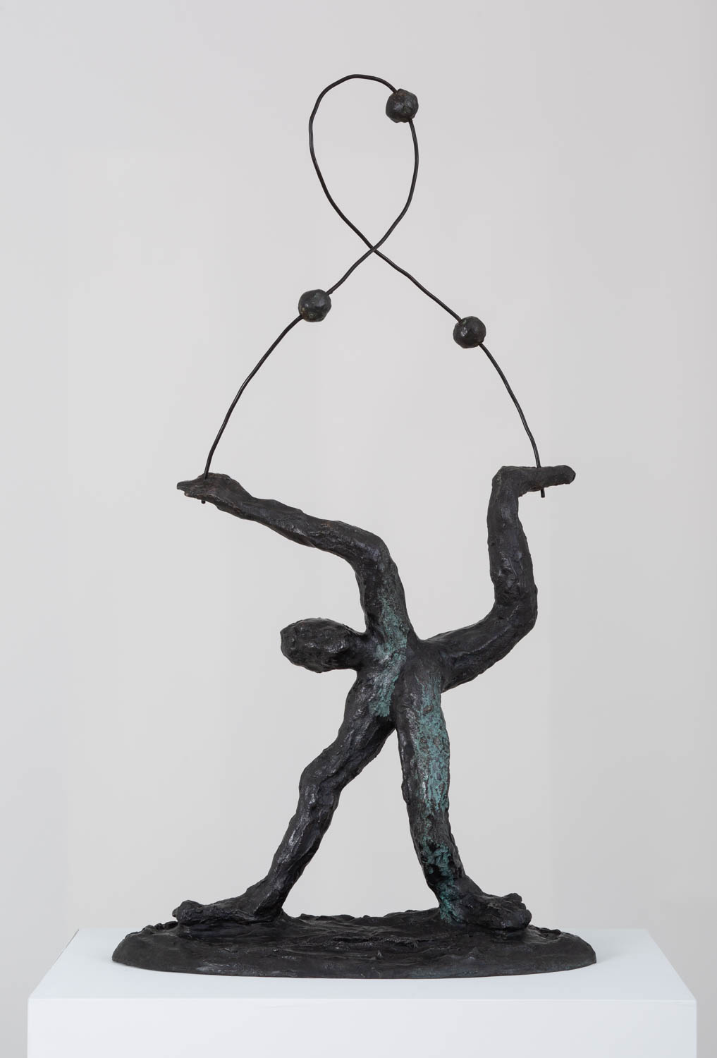 <em>man standing juggling three balls</em>, 2017<br />Bronze and steel<br />31 1/2 x 17 x 10 1/2 inches (80 x 43.2 x 26.7 cm)
